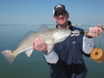 man with redfish